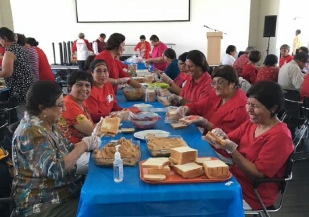 Volunteers made about 2,800 peanut butter and jelly sandwiches for the Calgary Drop-In & Rehab Centre on Sunday.
