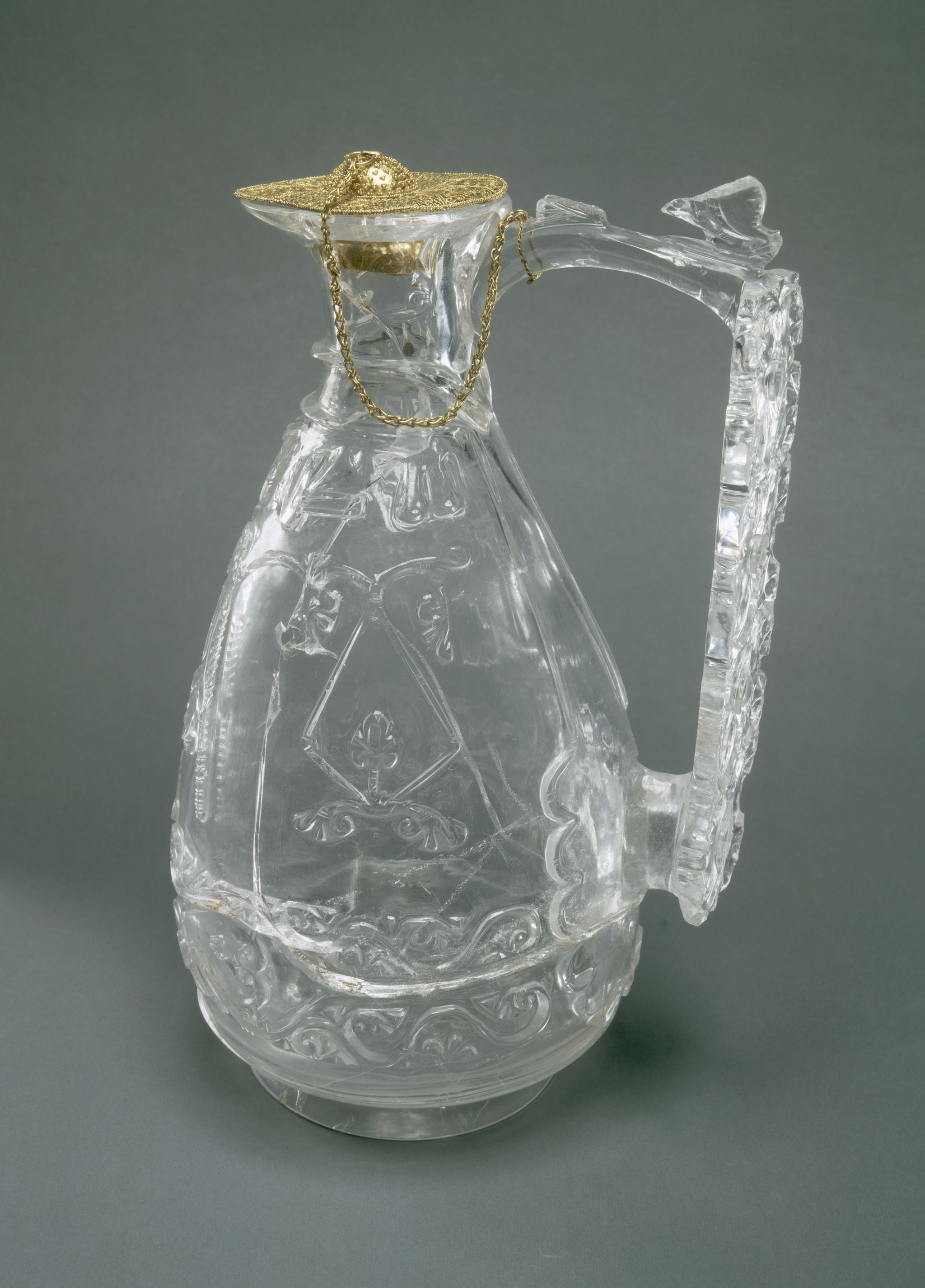 """Inscription: """"Blessings, satisfaction and [...] to its possessor"""" Ewer with inscription in Kufic script. Late 10th. or early 11th. century (lid: 11th century). Rock crystal: Cairo, Egypt. Lid: central or southern Italy. From the Louvre"""