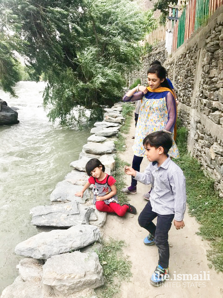 Nighat's daughter playing with her cousins in Chitral. One can see the risk of danger from the fast-flowing water