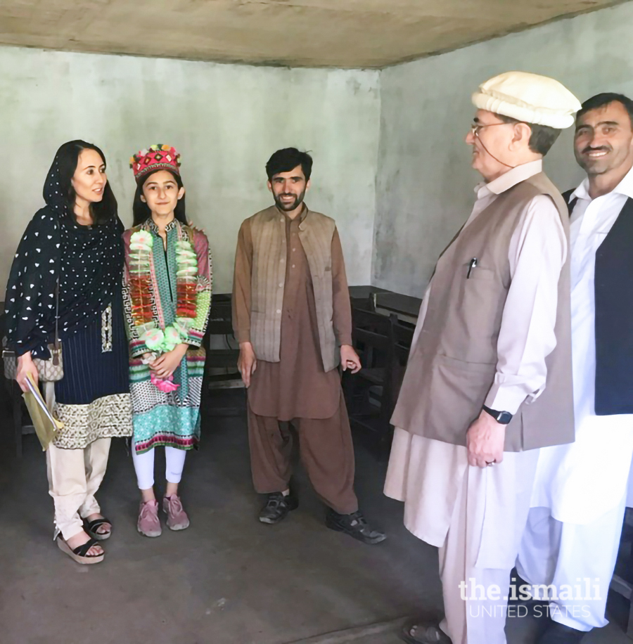 Nighat and her daughter with Mr. Islamuddin, the principal of Pamir Public School in Garam Chashma, where she funded an ECD center