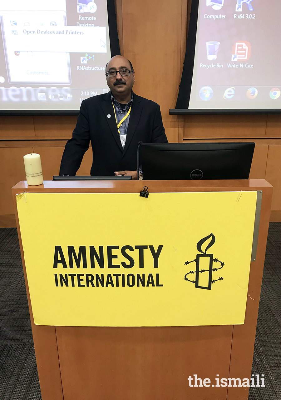 Aziz Nathoo speaking at a national meeting of Amnesty International on human rights and legal rights for refugees who often do not have adequate legal documents.