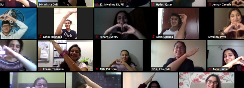Global Encounters CONNECT participants from all over the world form a heart shape together to pose for a virtual group photo.