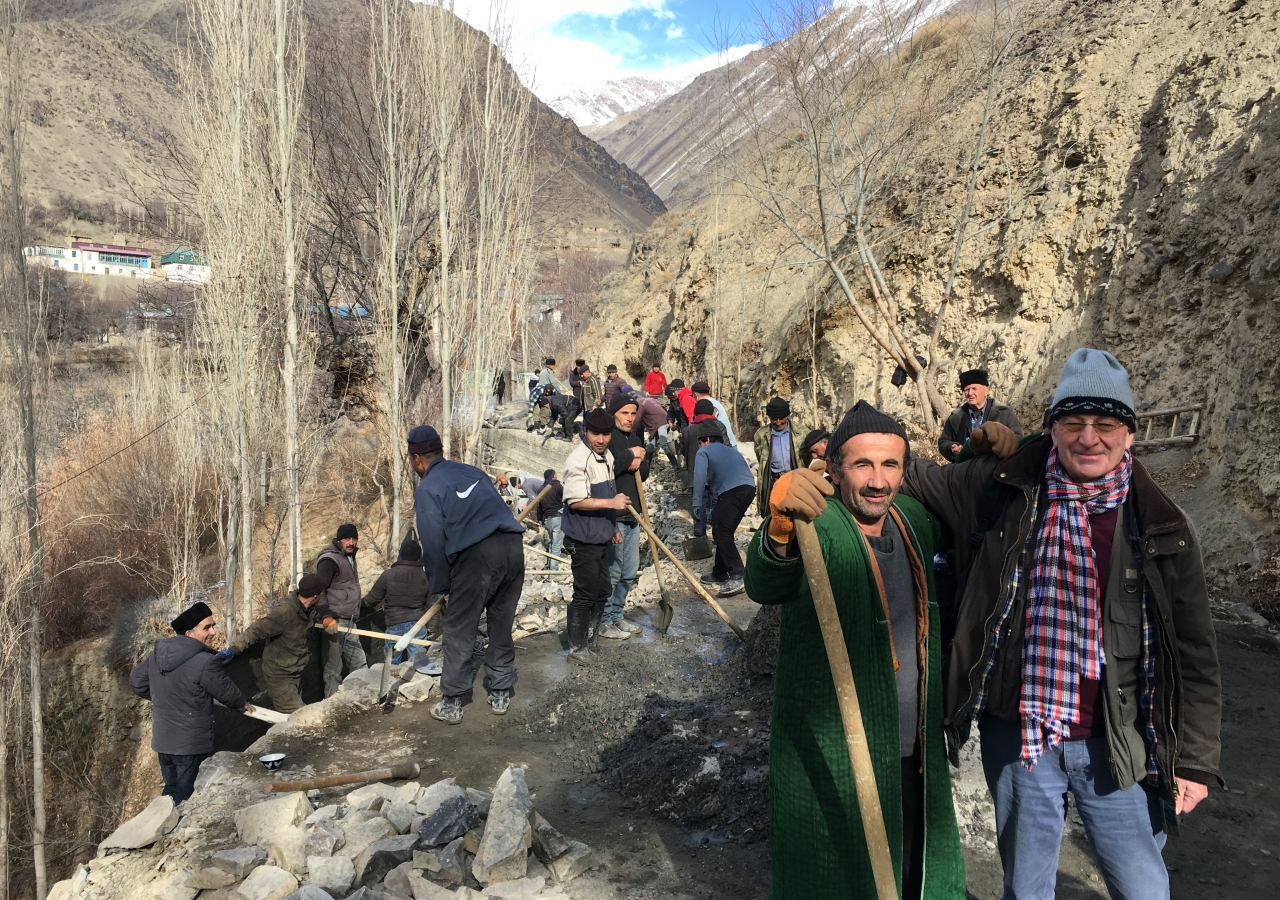 "Shiraz Billing (on right) with a ""Hashar"" (community mobilisation) team of villagers repairing a road that had collapsed due to a landslide. This road accesses the Shams al Tabrizi shrine and mosque."