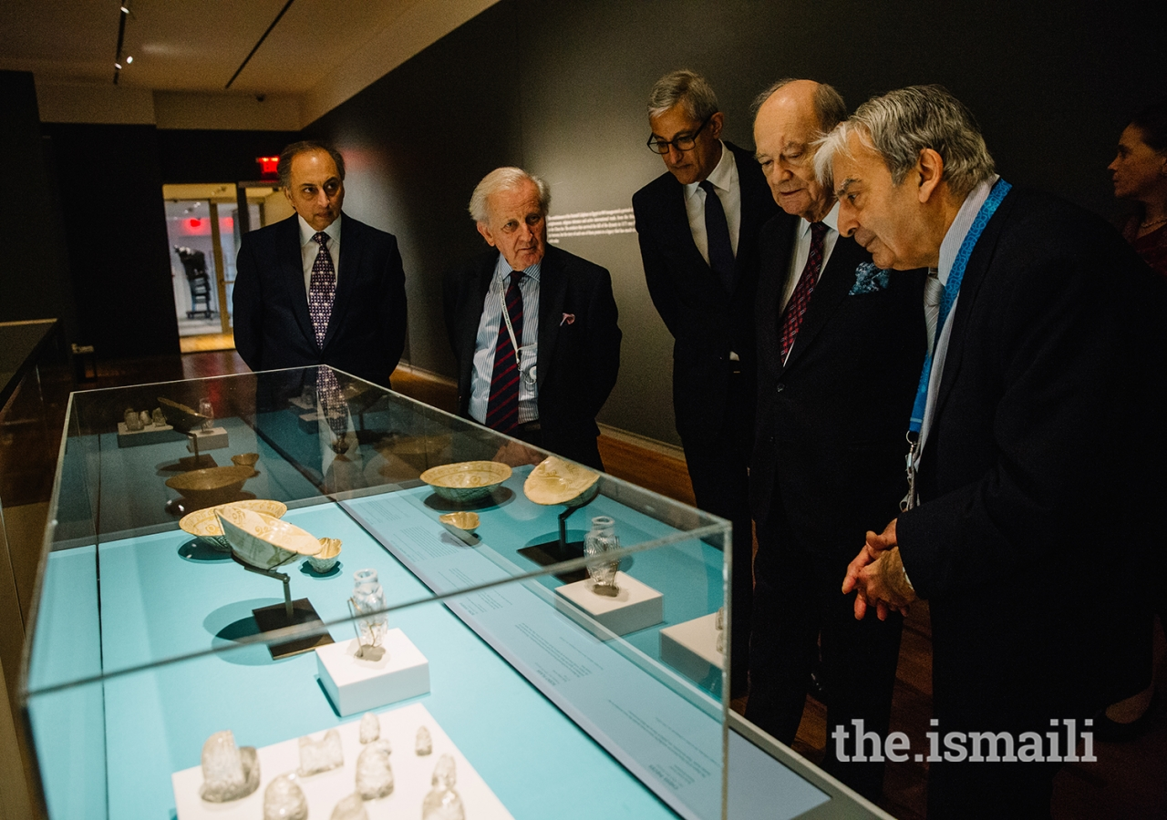 Prince Amyn views rock crystal chess pieces and decorative bowls from the Fatimid period during a tour by curator Dr. Assadullah Souren Melikian-Chirvani. The World of the Fatimids exhibition features 87 artefacts from over a dozen institutions.