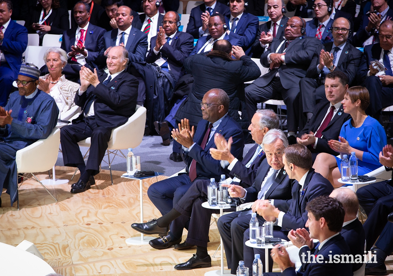 Mawlana Hazar Imam and world leaders applaud as Germany's Chancellor Angela Merkel concludes her address to the inaugural Paris Peace Forum.