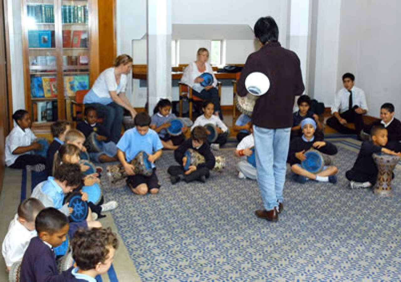 School children learn to play the daf, an Iranian percussion instrument