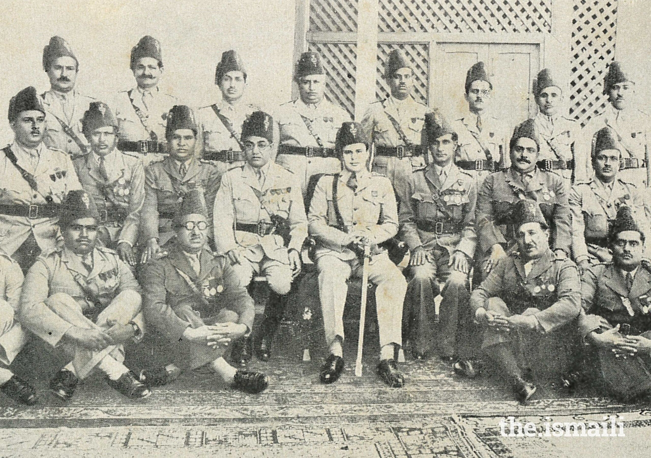 Prince Aly Khan in IVC uniform with IVC officers.