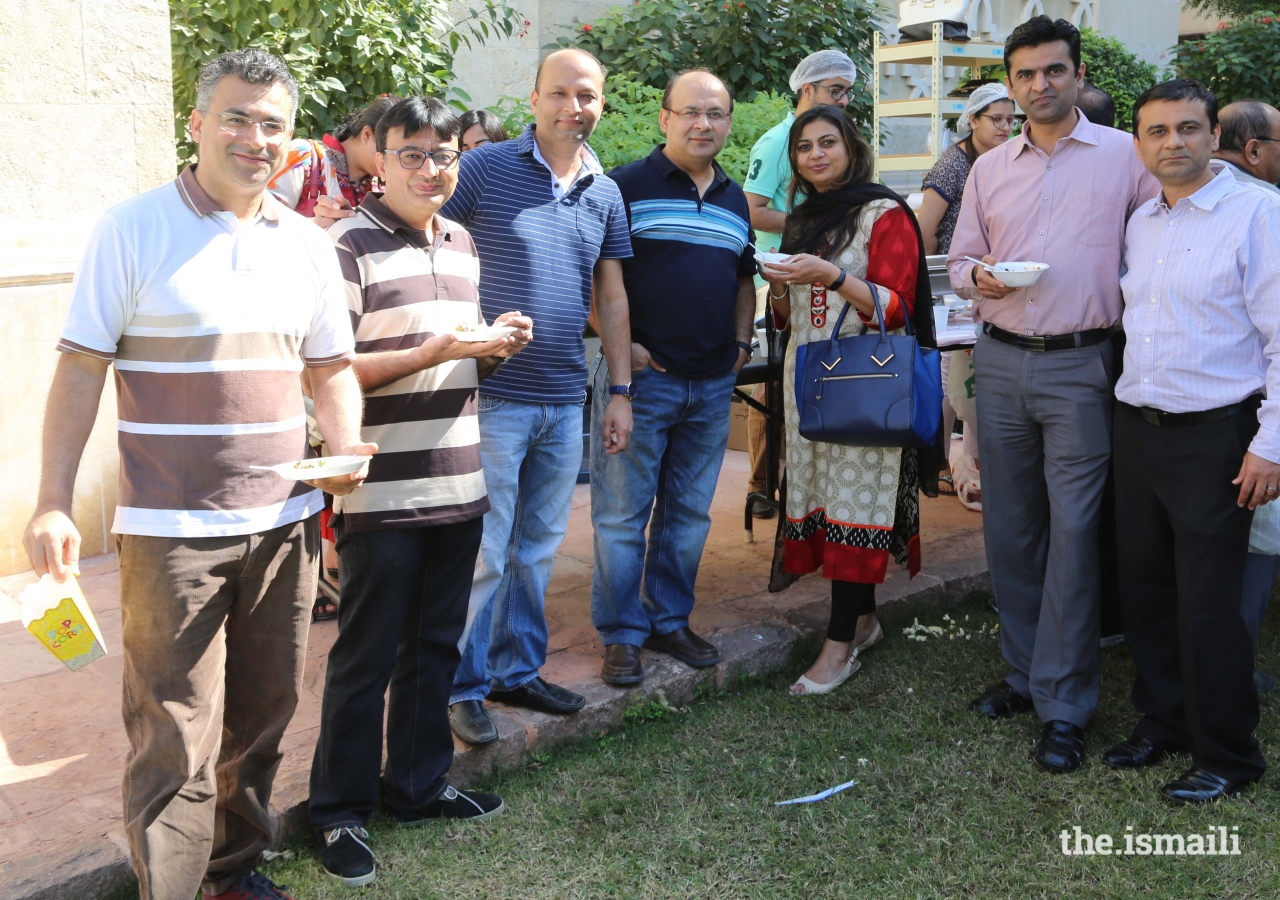 Members of the Jamat enjoying a delicious snack during the Mela
