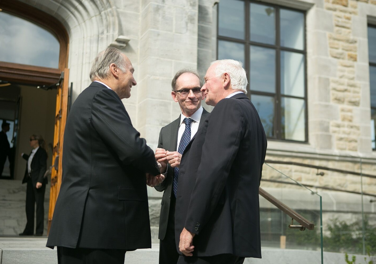 Mawlana Hazar Imam and Governor General David Johnston with John McNee, Secretary General of the Global Centre for Pluralism, on the footsteps of the 330 Sussex Drive headquarters in Ottawa.