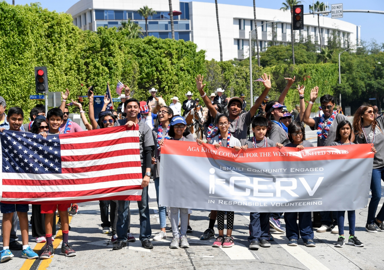 Ismaili Community Engaged in Responsible Volunteering (I-CERV) participates in the July 4th parade in Santa Monica, California.