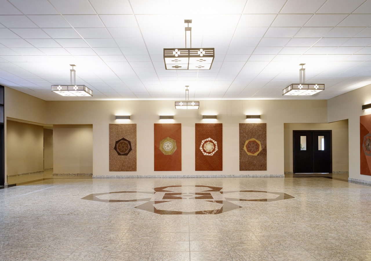 Social Lobby with handcrafted tapestries and heptagonal motif inlays.
