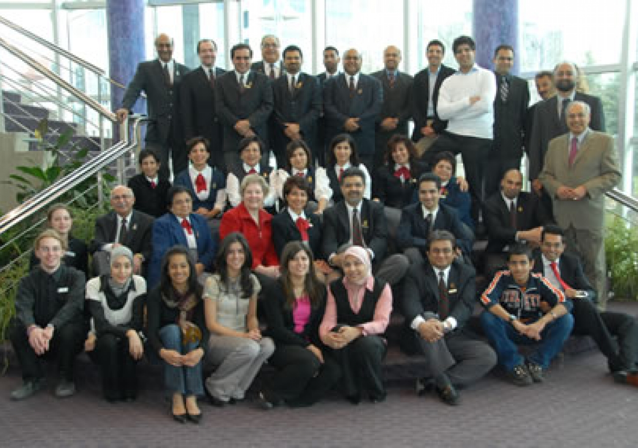 Edmonton volunteers and participants gather in the lobby of the Timms Centre after the Milad celebration