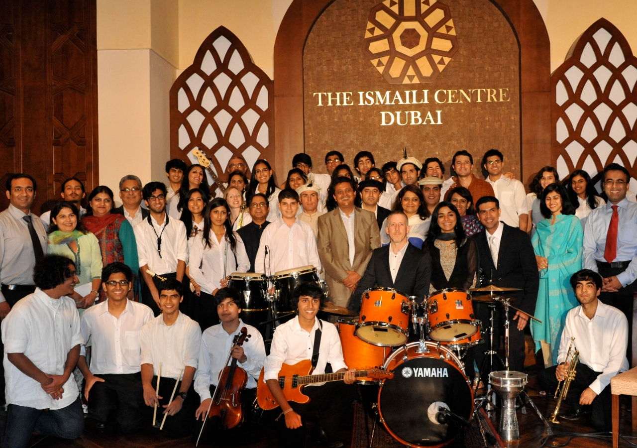 Members of the UK-based Ismaili Community Ensemble gather for a photograph at the Ismaili Centre, Dubai.