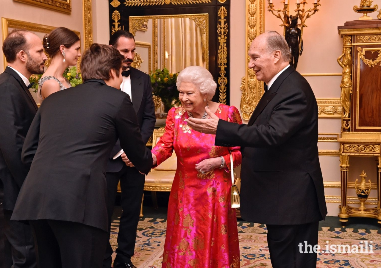 Mawlana Hazar Imam introduces Her Majesty the Queen to members of his family including Prince Rahim, Princess Salwa, Prince Hussain and Prince Aly Muhammad.