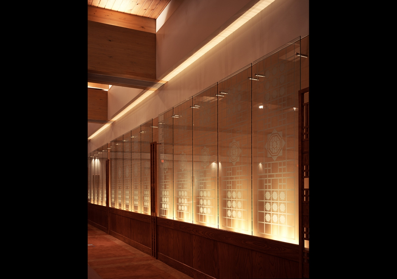 The motif of the Ismaili Jamatkhana and Center, Houston, repeated on a succession of glass panels. Gary Otte