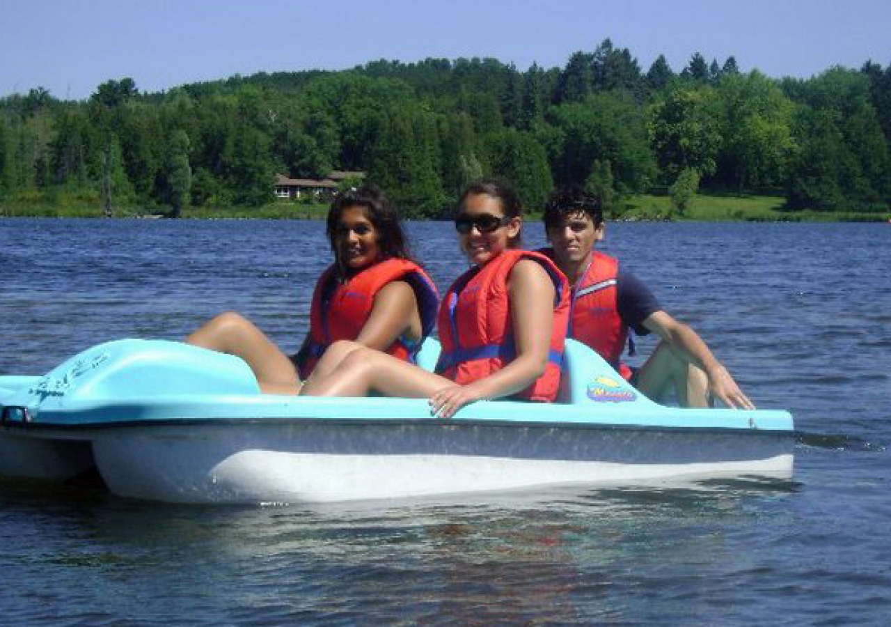 Al-Ummah participants enjoy a sunny day in a paddle boat on the lake.
