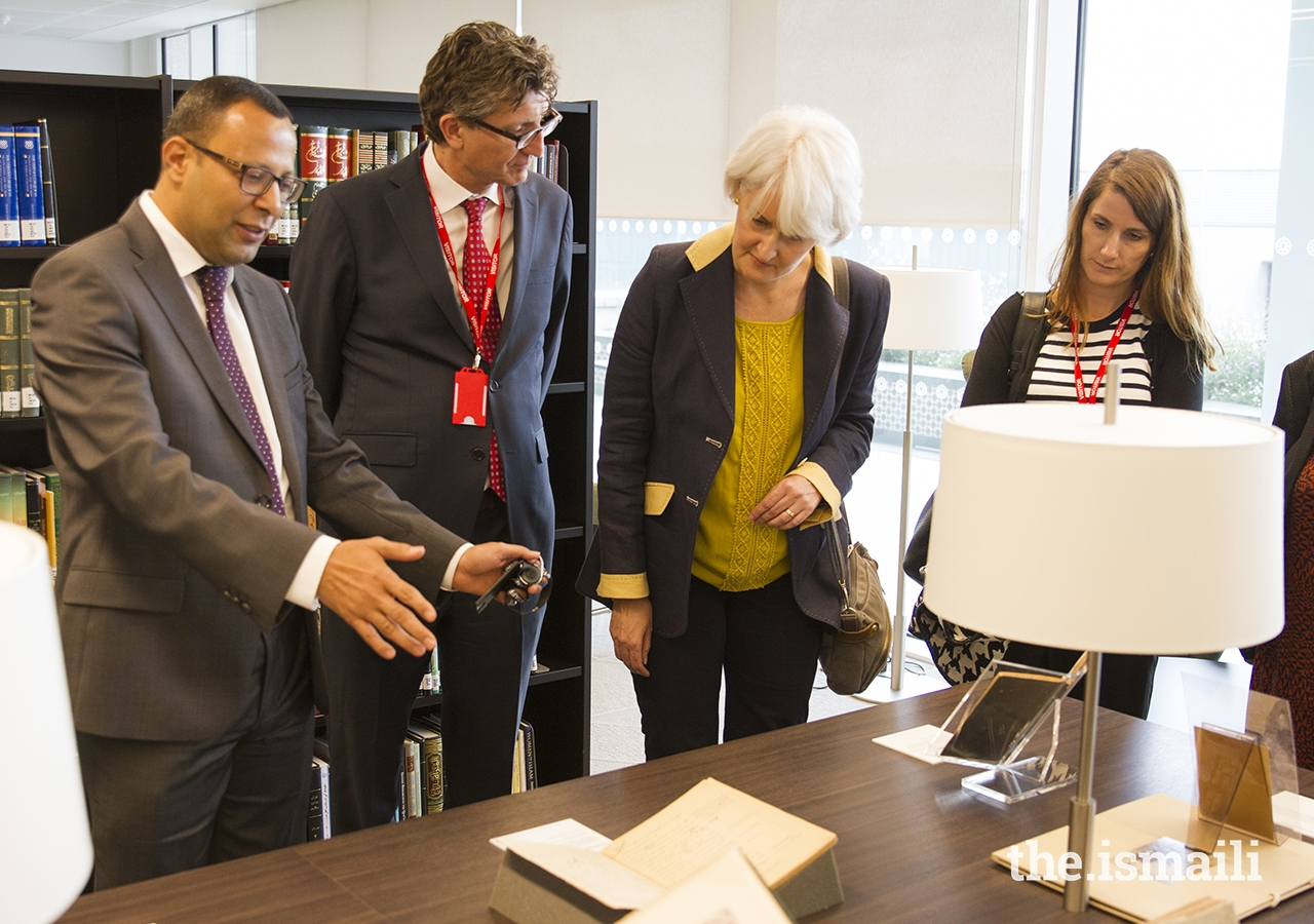 Dr Walid Ghali, Head of the Aga Khan Library, shares a selection of rare books during a tour of the library.