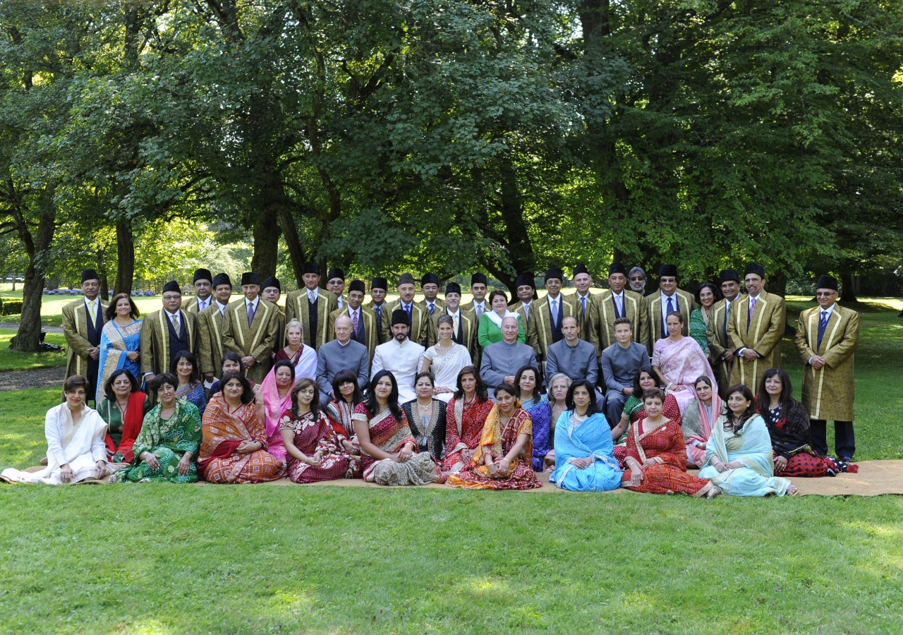 Mawlana Hazar Imam, Prince Rahim, Princess Salwa and members of the Imam's family pose for a photograph with the members of the Ismaili Leaders' International Forum after the nikah ceremony.