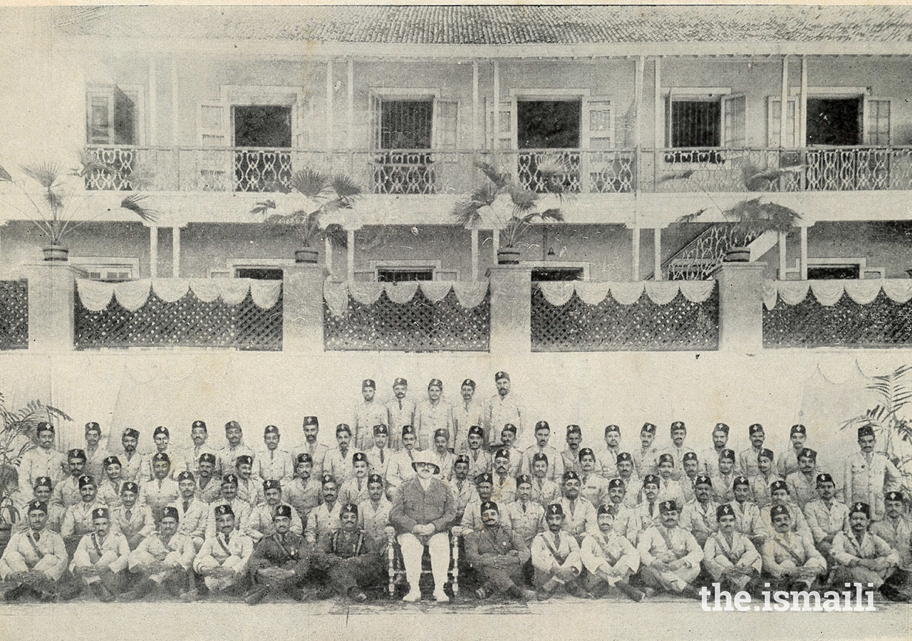 Mawlana Sultan Mahomed Shah in his IVC Colonel uniform surrounded by members of the IVC in India.