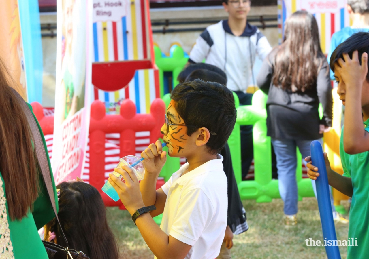 Face painting fun at the Mulaqat Mela