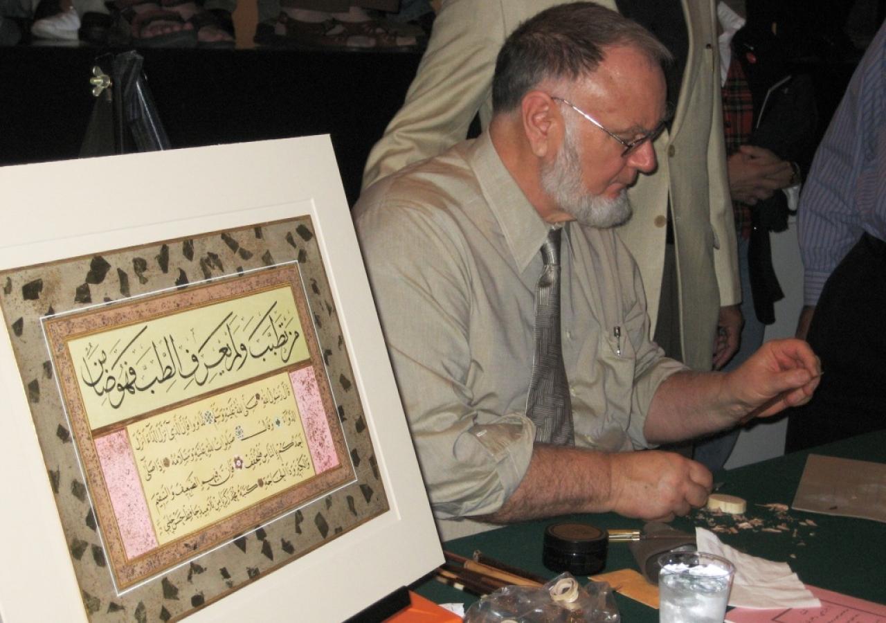 Zakariya demonstrating the art of calligraphy during the workshop session.