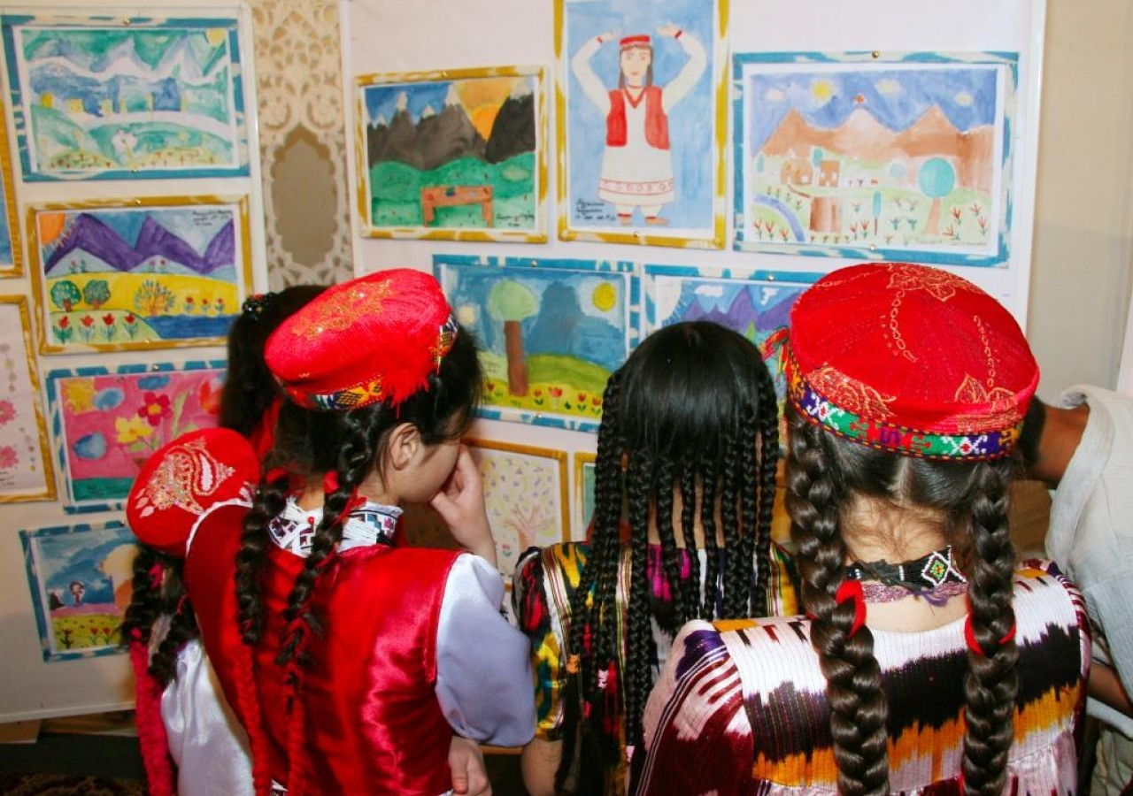 Children marvel at their own artwork exhibited outside the event hall.