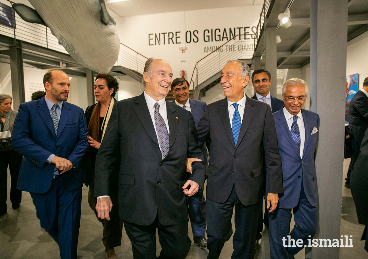 Mawlana Hazar Imam and President Marcelo Rebelo de Sousa share a light moment at The Living Sea photo exhibition in Lisbon.