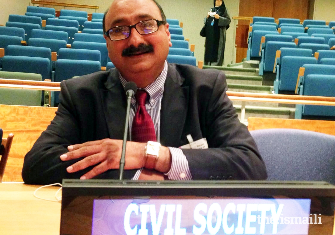 Aziz Nathoo poses for a photo after speaking about civil society at a United Nations conference.