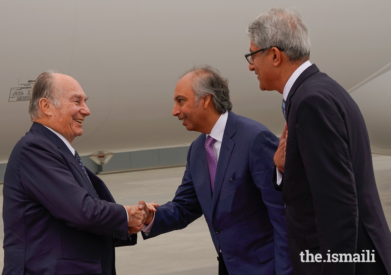 Mawlana Hazar Imam is greeted by AKDN Resident Representative for Canada Dr Mahmoud Eboo upon his arrival in Edmonton.