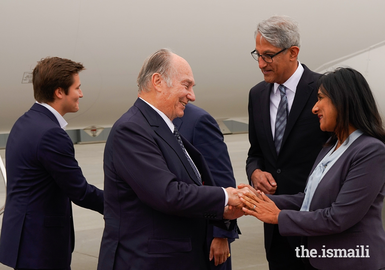 Vice-President of the Ismaili Council for Canada Karima Karmali greets Mawlana Hazar Imam upon his arrival in Canada accompanied by Prince Aly Muhammad.