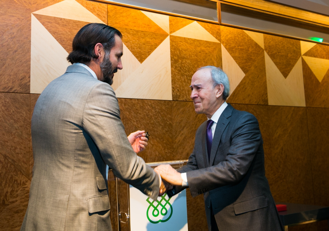 An emotional Dr Daftary receives his long-service recognition from Prince Rahim