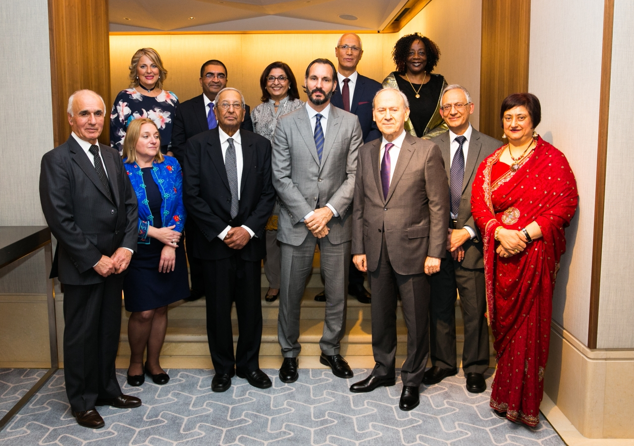 Prince Rahim joins members of staff recognised for their long-service at the IIS for a group photograph