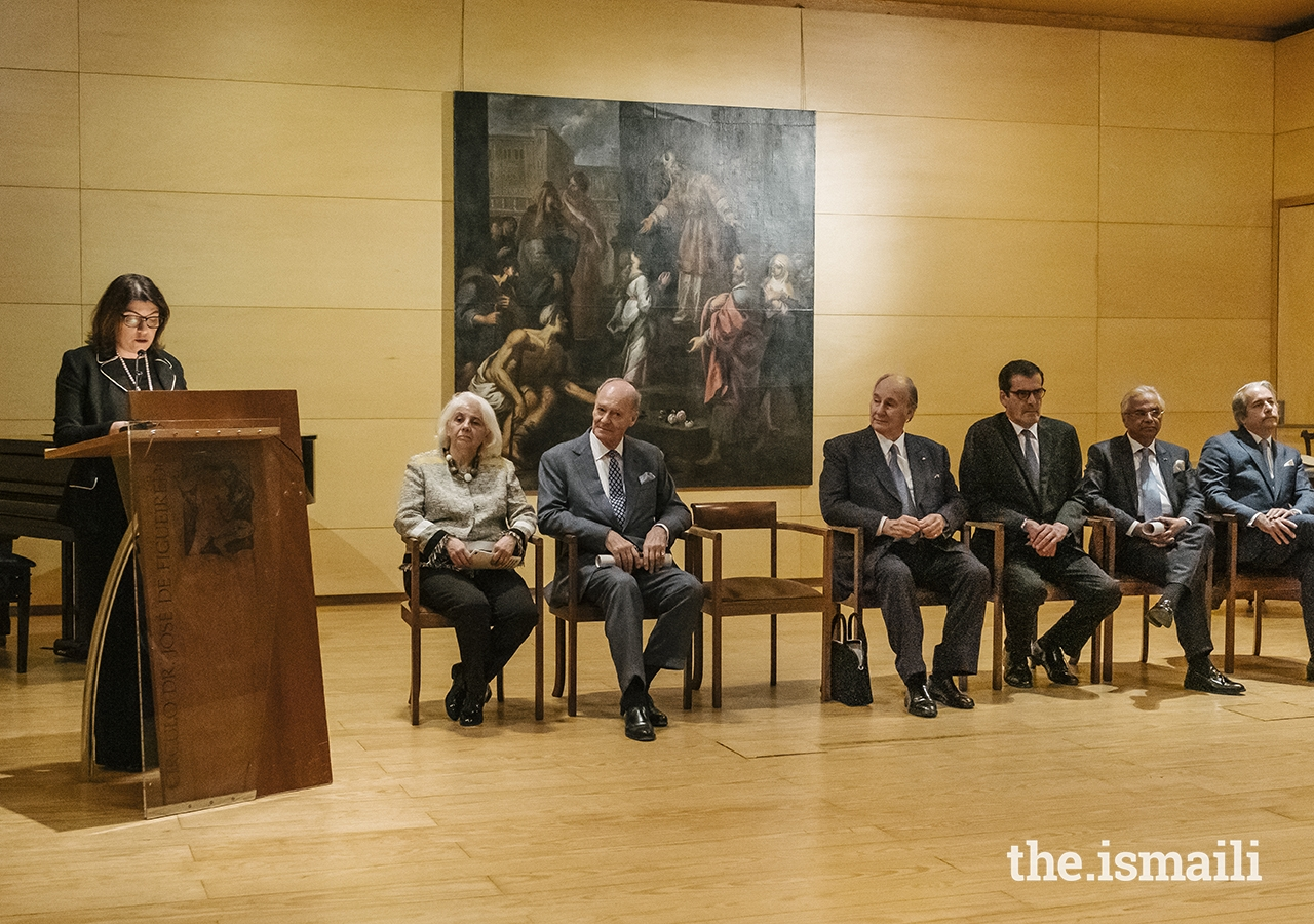 """Portugal's Secretary of State for Culture Angela Ferreira speaks at the donation ceremony. The painting entitled """"Presentation of the Virgin at the Temple,"""" which was donated to the Museum by Mawlana Hazar Imam and Prince Amyn, is seen in the background."""