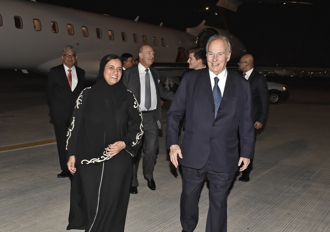 Mawlana Hazar Imam and Minister Sheikha Lubna bint Khalid proceed to the airport terminal as Prince Amyn and Prince Aly Muhammad follow. Gary Otte