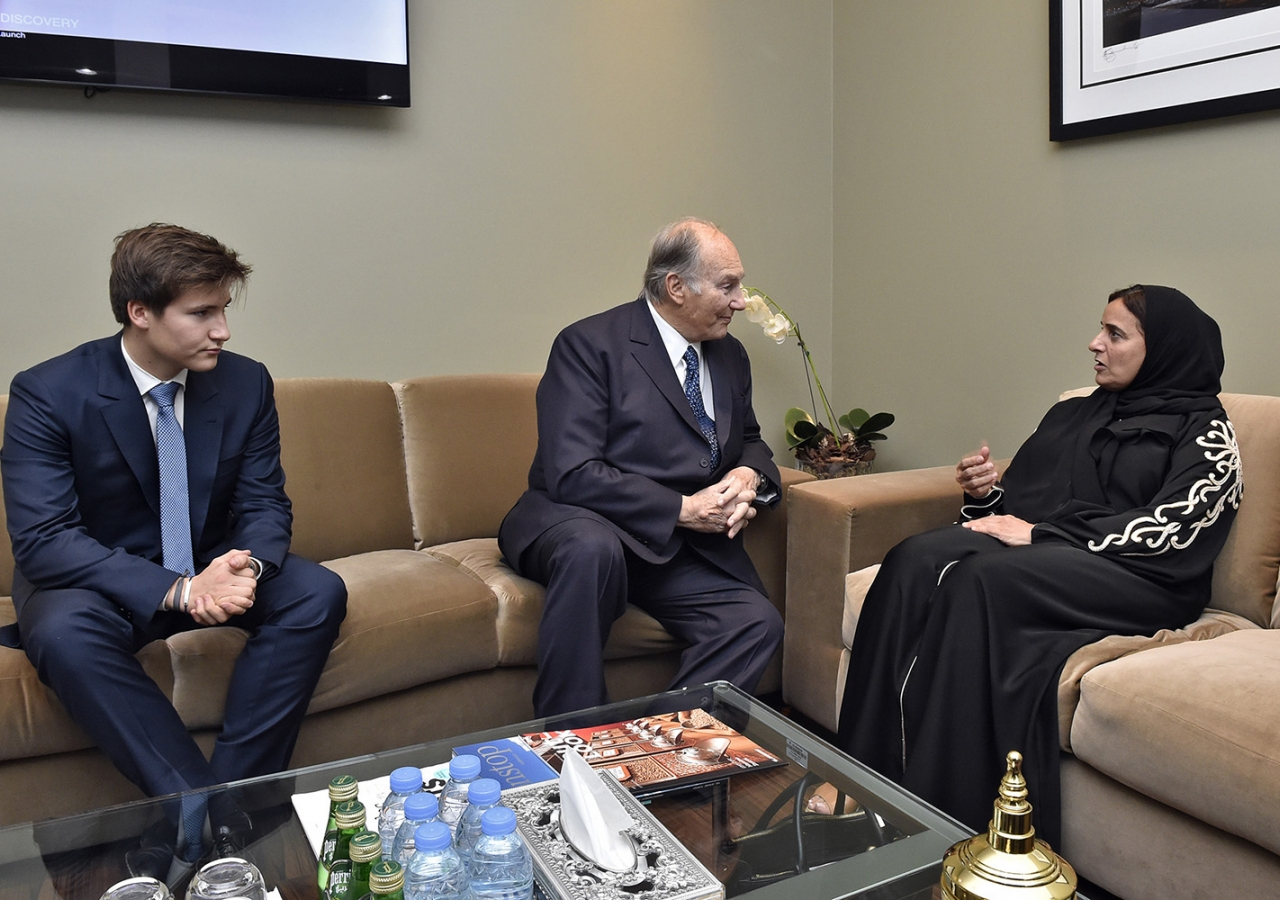 Mawlana Hazar Imam and Minister Sheikha Lubna bint Khalid in discussion as Prince Aly Muhammad looks on. Gary Otte