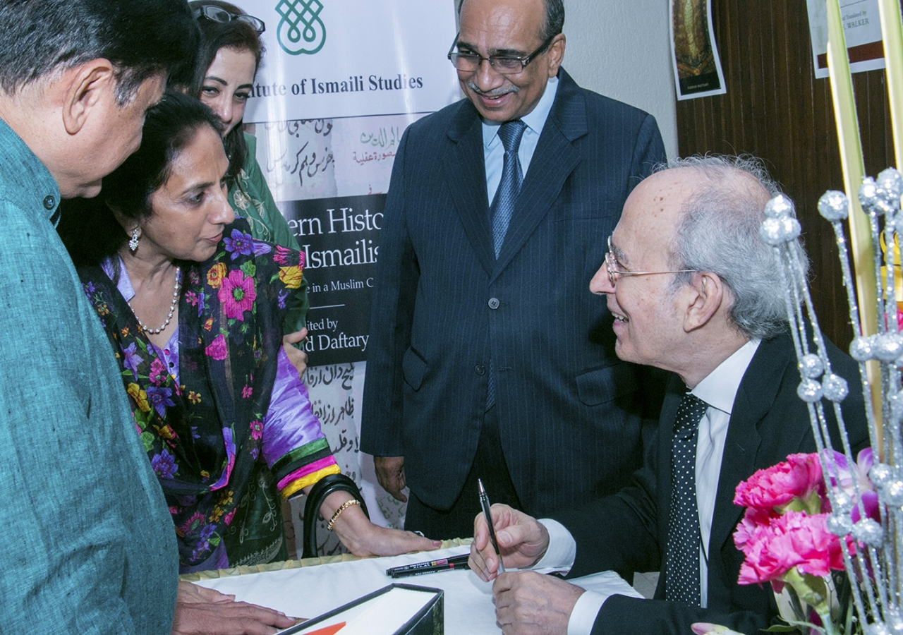 Dr Farhad Daftary signs books for audience members at a book launch event in Mumbai, India earlier this month. ITREB India