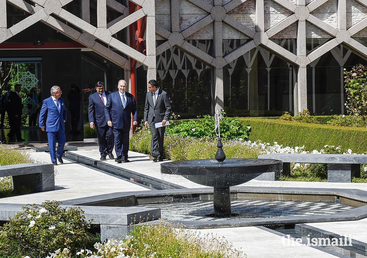 Mawlana Hazar Imam walks through the garden upon arriving at the Ismaili Centre Lisbon to meet with the Portugal jurisdiction Jamat.