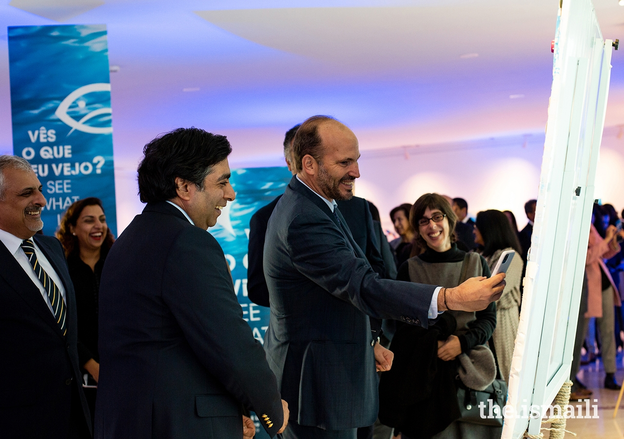 Prince Hussain enjoys a light moment at the inauguration of an exhibition of artwork designed by students from the Portugal Jamat's Talim (religious education) classes.