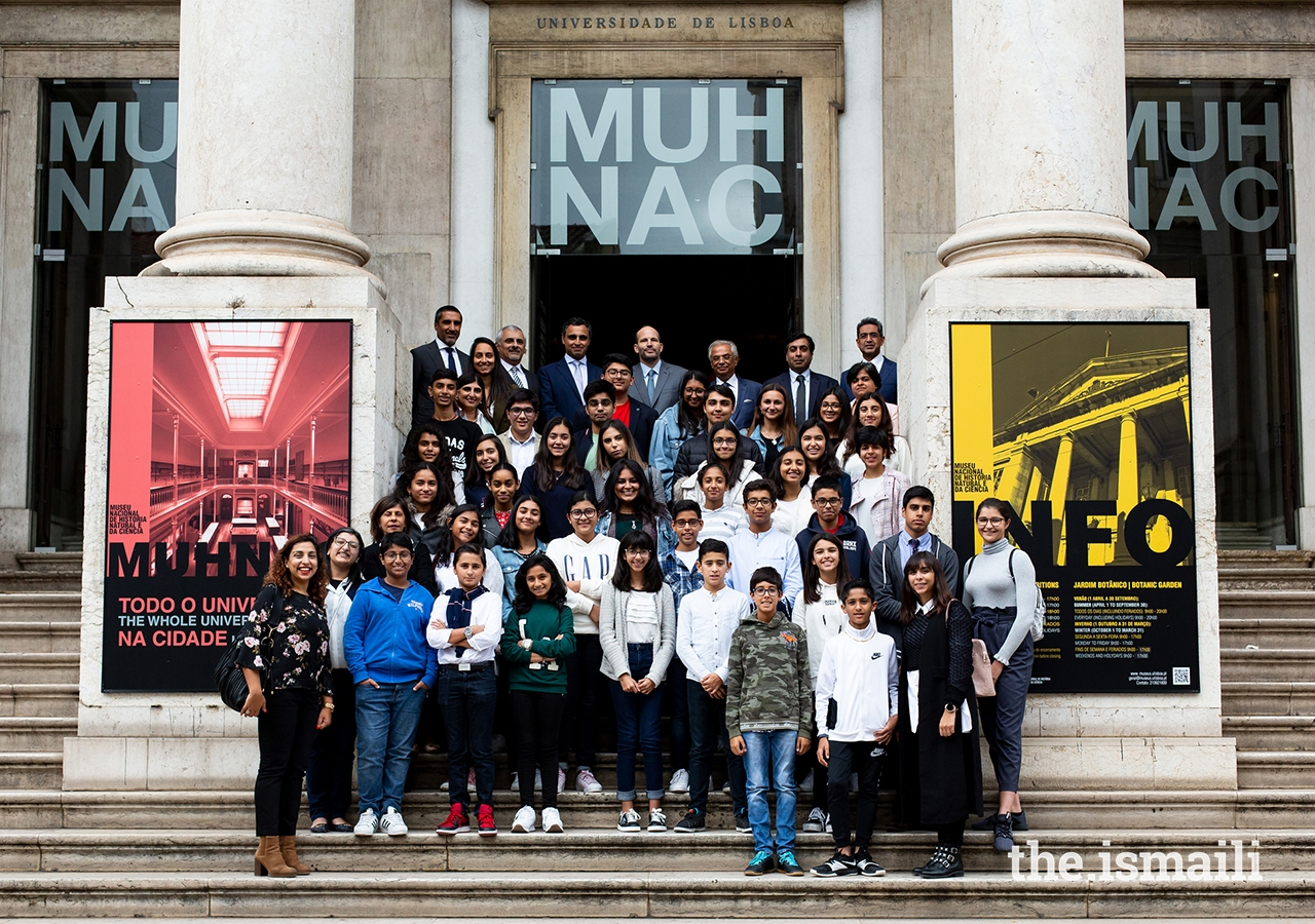 Prince Hussain poses for a group photograph with secondary students from the Lisbon Jamat's Talim (religious education) classes, at the National Museum of Natural History and Science in Lisbon.