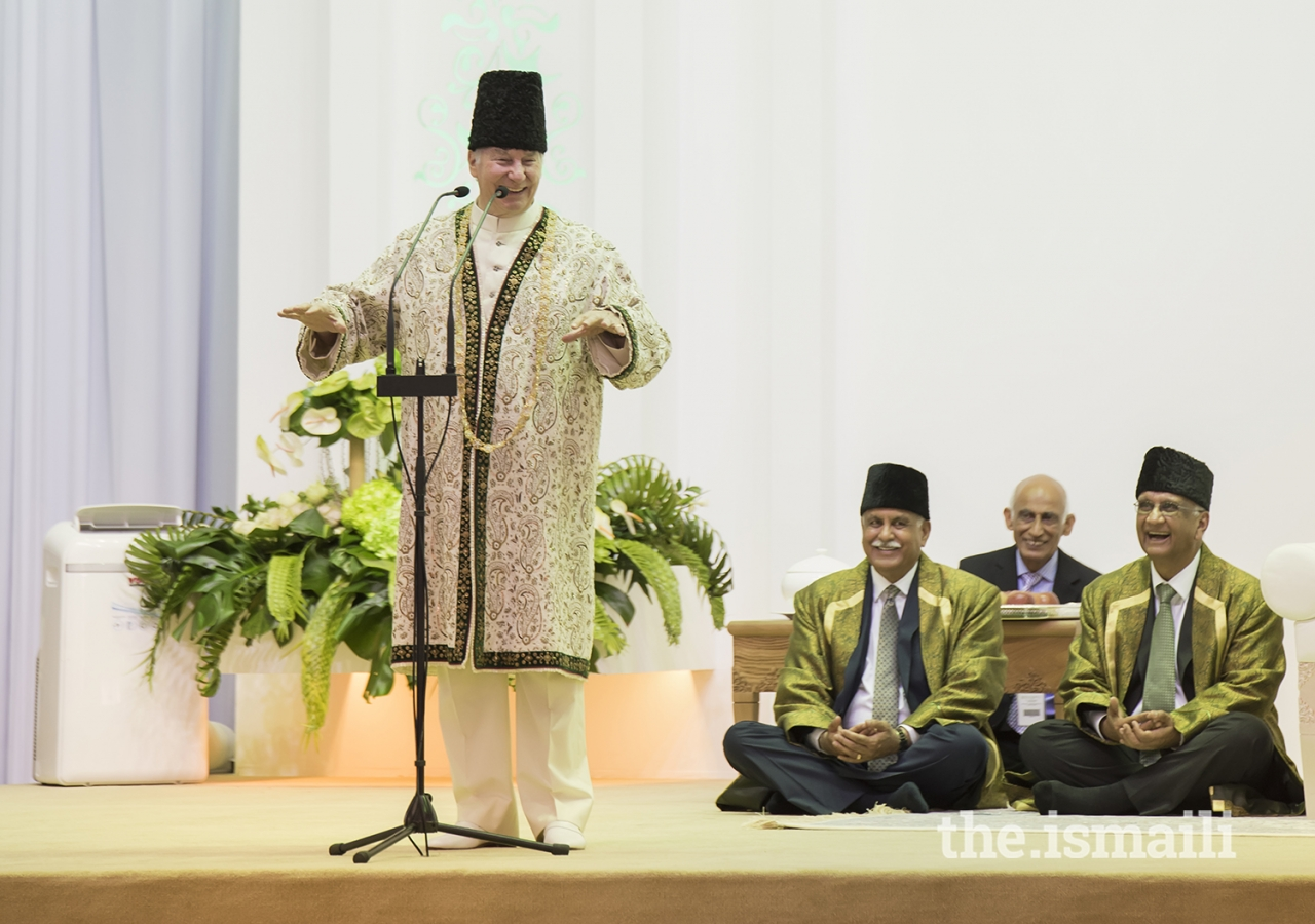 Mawlana Hazar Imam shares a light moment with the Jamat