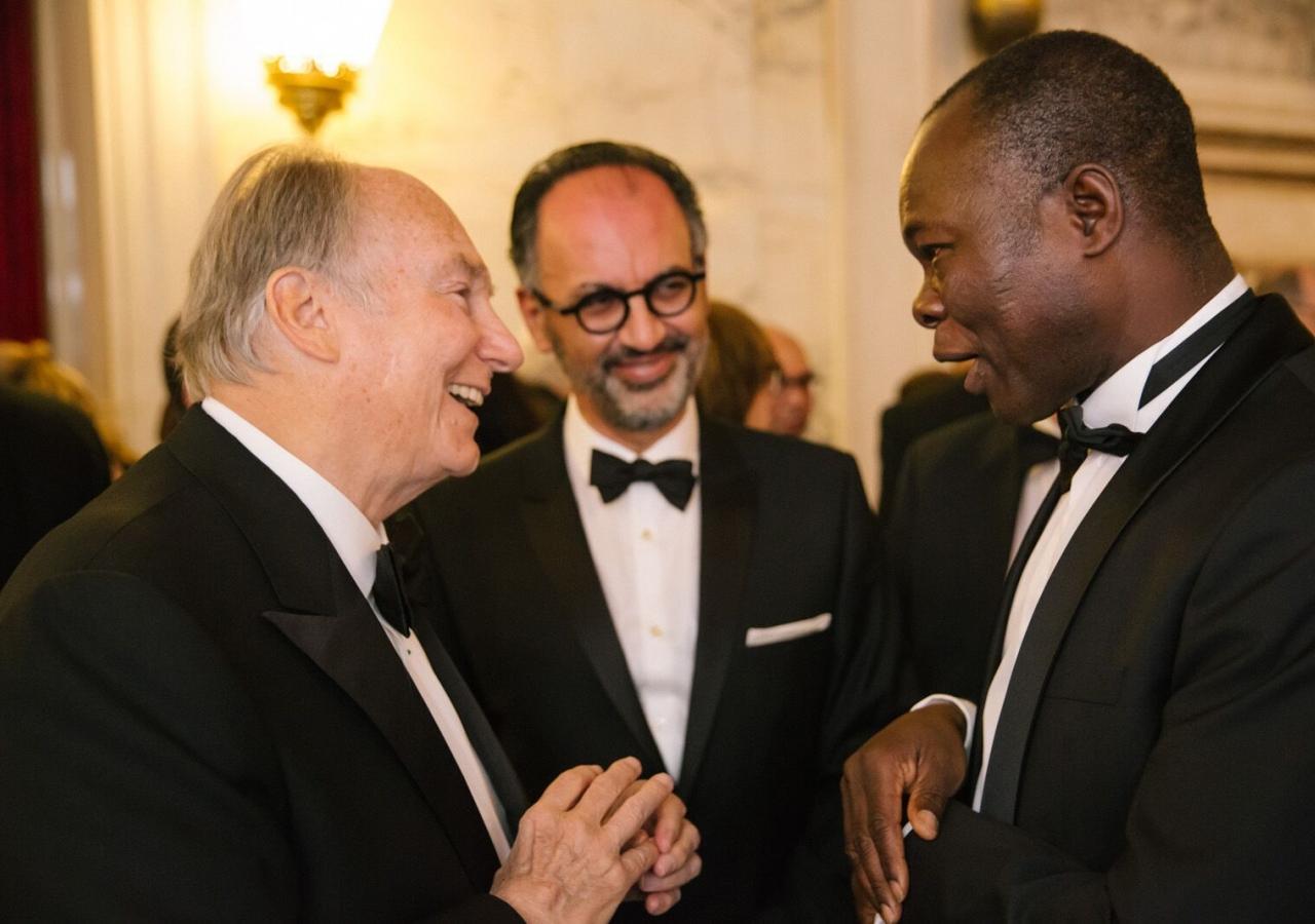 Mawlana Hazar Imam with Aga Khan Award for Architecture Director Farrokh Derakhshani and 2004 laureate Diébédo Francis Kéré.