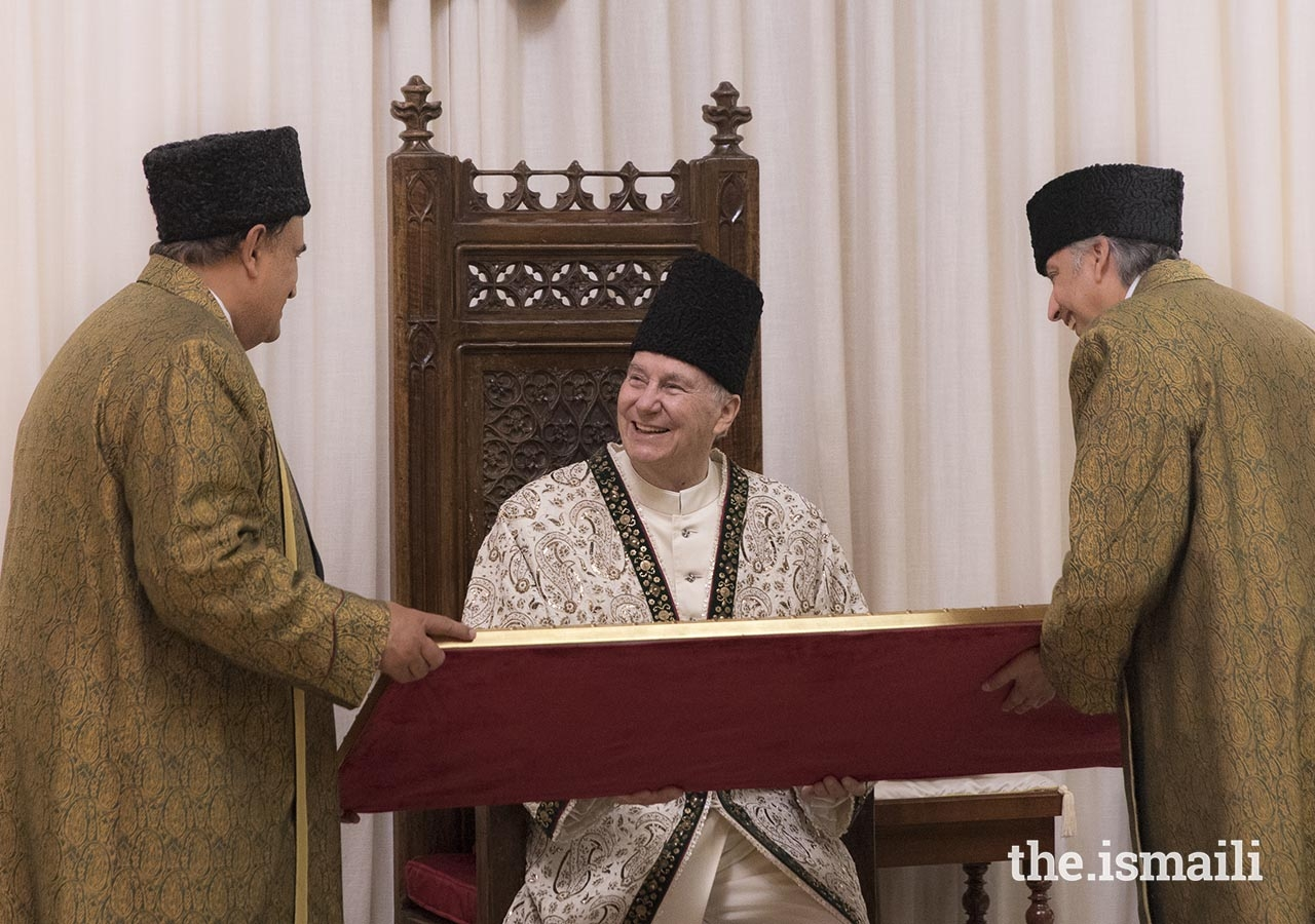 On the occasion of the designation of the Seat of the Ismaili Imamat, Mawlana Hazar Imam is presented with a gift on behalf of the global Jamat.