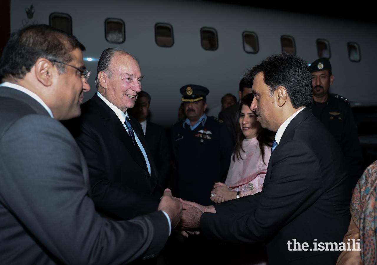 Mawlana Hazar Imam is welcomed by Ismaili Council for Pakistan President Hafiz Sherali and Vice President Hussein Tajani.