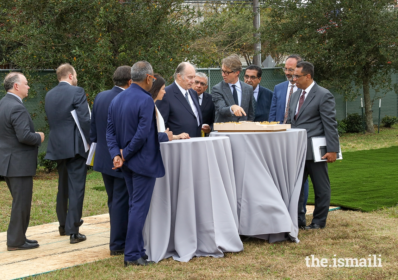 Landscape architect Thomas L. Woltz shows Mawlana Hazar Imam a model of the Ismaili Center Houston gardens as lead design architect Farshid Moussavi and Ismaili Council for the United States President Al-Karim Alidina look on.