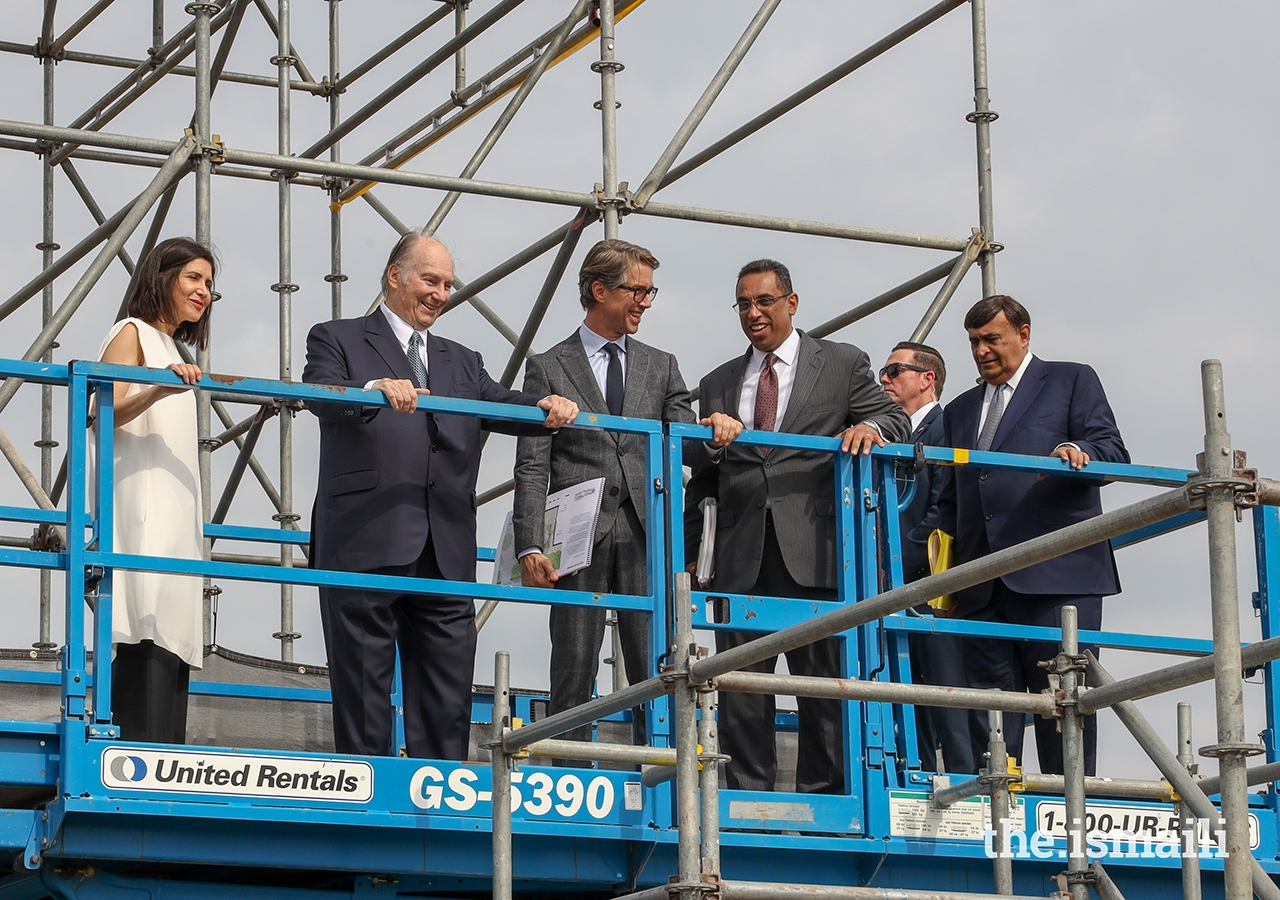 Lead design architect Farshid Moussavi, Mawlana Hazar Imam, landscape architect Thomas L. Woltz, and Ismaili Council for the United States President Al-Karim Alidina survey the future site of the Ismaili Center Houston from above.