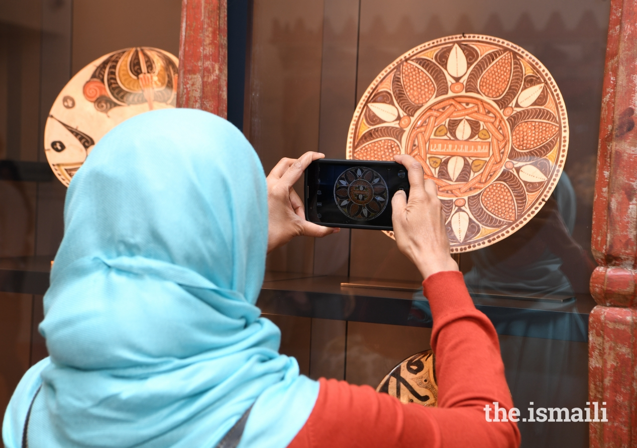 Dr. Sarah Sayeed photographs early Islamic ceramics from the 17th Century in the Bellerive Room.