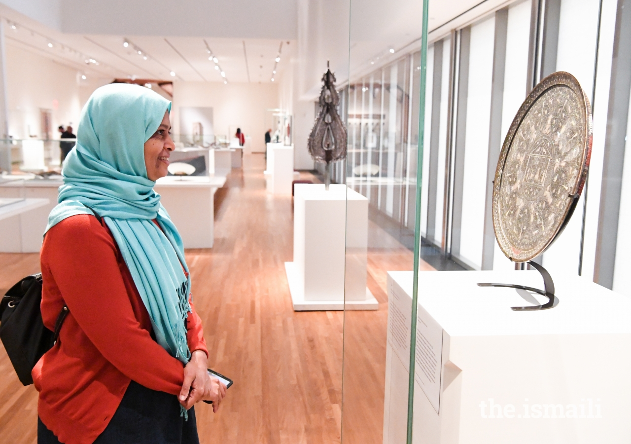 Dr. Sarah Sayeed admires the artifacts at the Museum.