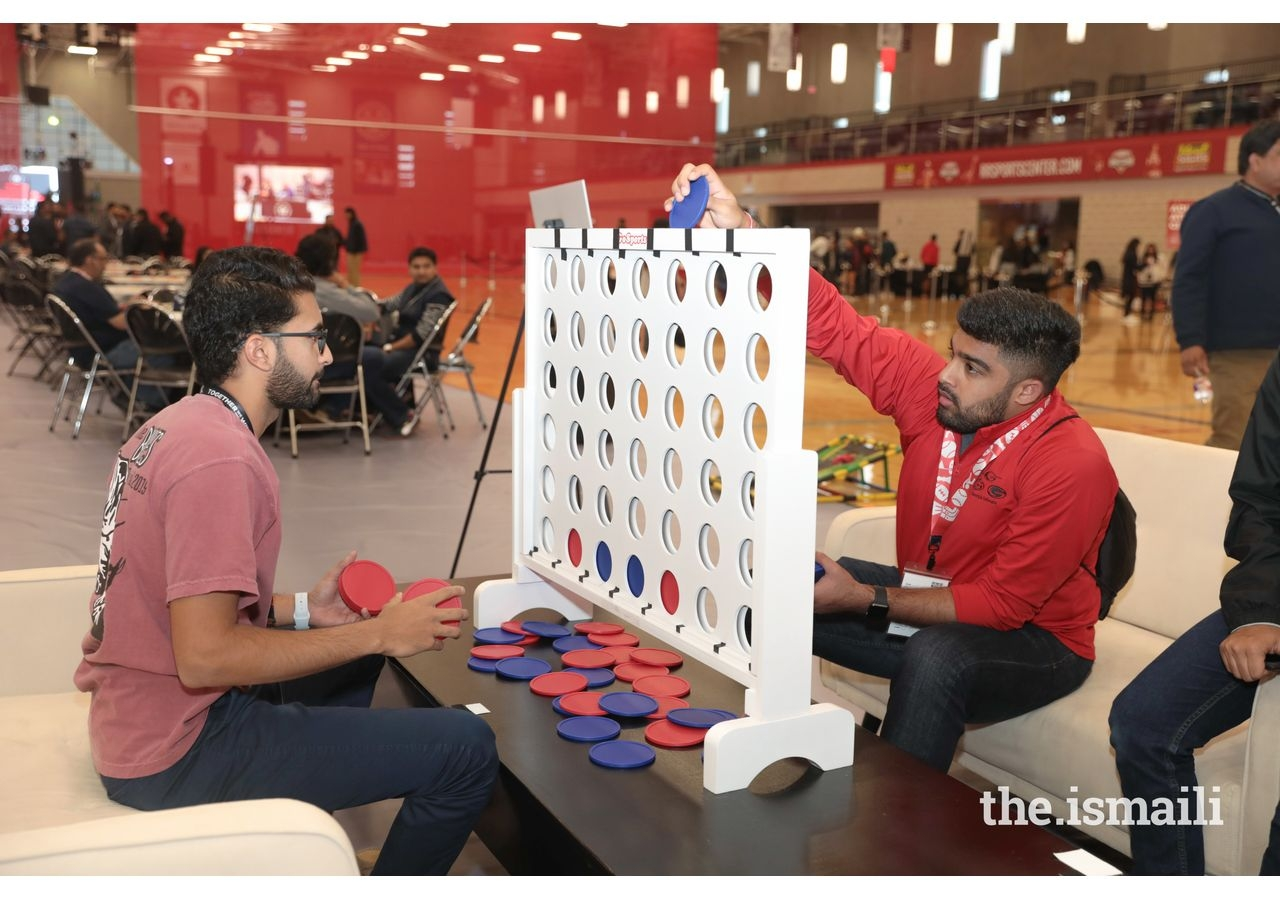 Athletes enjoy activities and games at the Athlete's Lounge.