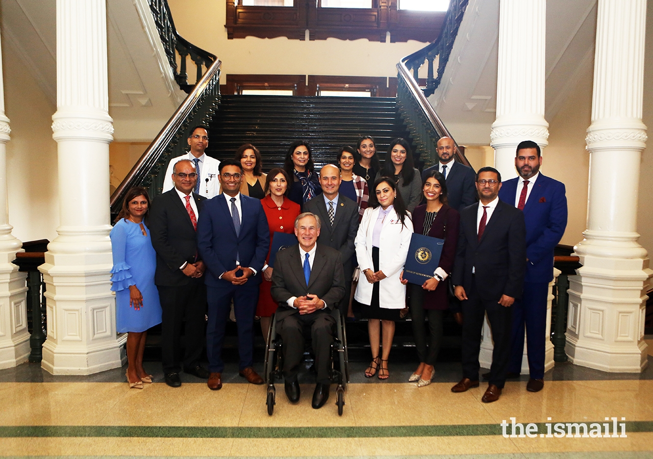 Texas Governor Greg Abbott poses with members of the Ismaili Council for the Southwestern US and a number of Ismaili volunteers at the Texas State Capitol on 26 May 2021.