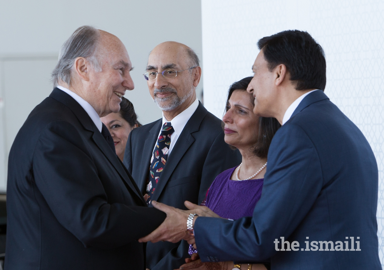 At the airport, Mawlana Hazar Imam greets Jamati leaders assembled for his departure.